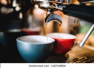 Professional espresso machine preparing fresh espresso and cappuccino in local pub, bistro or restaurant
