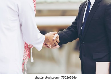 professional experience. multi-ethnic Lawyer from Law Firms Justice Legal or business people or Investor handshake.  Arabic people shaking hands and Agreement Diversity Asian business man Partnership