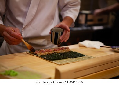 Professional and experienced sushi chef is focus and carefully make sushi with confident and dedication to perfection. Precision and Finesse at its best practice to achieve top performance in business
