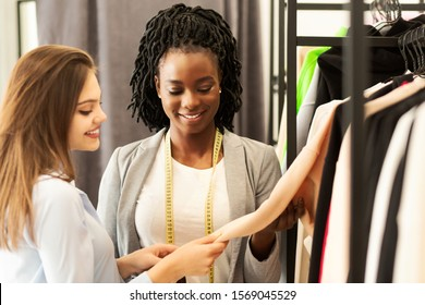 Professional Fashion Designer Selling Exclusive Clothes To Her Client In Own Showroom. Fashion Business Concept. Copy Space