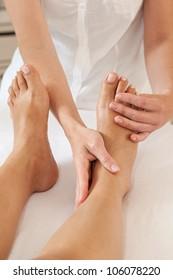 Professional feet massage - masseuse and female feet