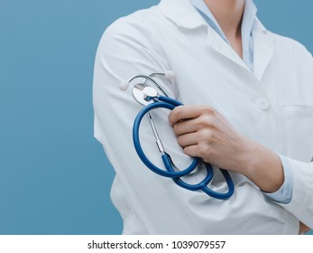 Professional female doctor posing and holding a stethoscope, healthcare professionals