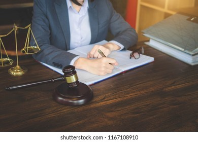Professional female lawyers working at the law firms. Judge gavel with scales of justice. Legal law, lawyer, advice and justice concept.