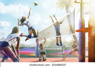 Professional female volleyball players in action on the court