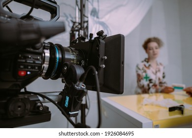 Professional film and video camera on the set. Shooting shift, equipment and group. Modern photography technique.