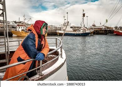 Professional fisherman in winter scandinavian port