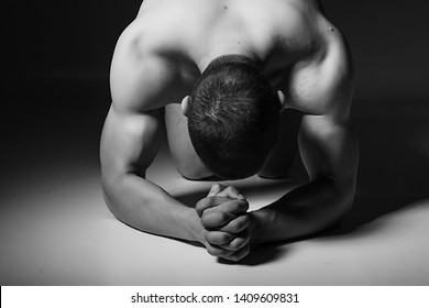 Professional fitness photo shoot, black and white photos. Young athletic male model, natural and artistic pictures