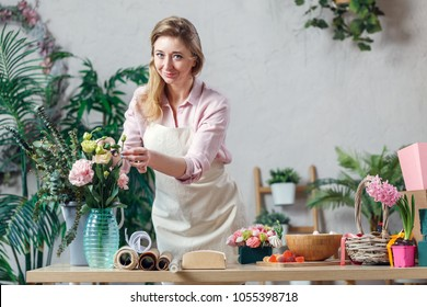 Professional florist working in flower shop.