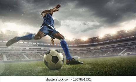 Professional football or soccer player in action on stadium with flashlights, kicking ball for winning goal, wide angle. Concept of sport, competition, motion, overcoming. Field presence effect. - Shutterstock ID 1687861552