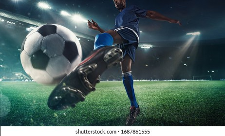 Professional football or soccer player in action on stadium with flashlights, kicking ball for winning goal, wide angle. Concept of sport, competition, motion, overcoming. Field presence effect. - Shutterstock ID 1687861555