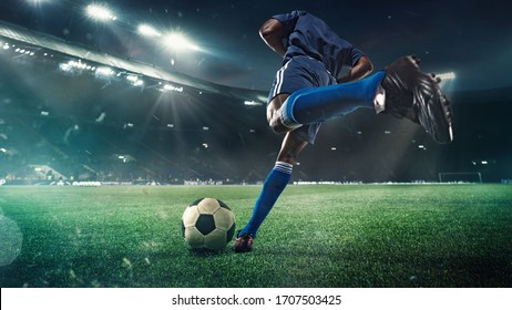 Professional football or soccer player in action on stadium with flashlights, kicking ball for winning goal, wide angle. Concept of sport, competition, motion, overcoming. Field presence effect. - Shutterstock ID 1707503425