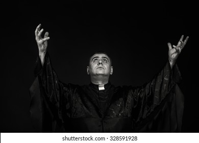 The professional game stage actor at the camera in the image of the priest. Theatrical productions. Professional makeup and costume designer. Photo for religious and cultural magazines and websites.