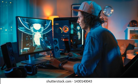 Professional Gamer Playing First-Person Shooter Online Video Game on His Powerful Personal Computer with Colorful Neon Led Lights. Young Man is Wearing a Cap. Living Room Lit with Warm Lamps. Evening.