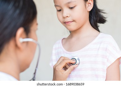professional general medical pediatrician doctor gown listen lung and heart sound of asia child patient with stethoscope. for virus symptom. epidemic coronavirus (2019-nCoV) outbreak concept.