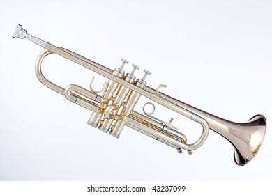 A professional gold brass trumpet isolated against a white background in horizontal format.