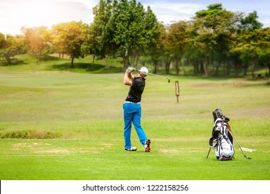 Professional golfer shot Golf ball on Golf course in competition golf Tournaments.,golfer putting on green