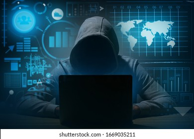 Professional hacker using laptop at table against dark background