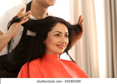 Professional hairdresser making stylish haircut
