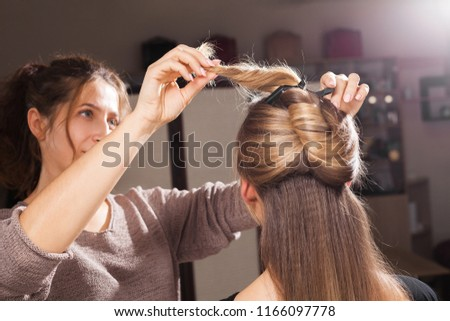 Professional Hairdresser Making Unusual Coiffure Brown Stock Photo