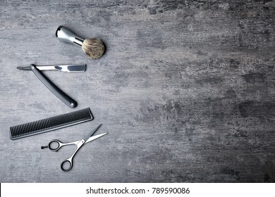 Professional hairdresser set for men on gray table, top view