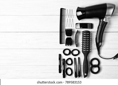 Professional hairdresser set on wooden table