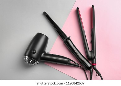 Professional hairdresser's equipment on color background