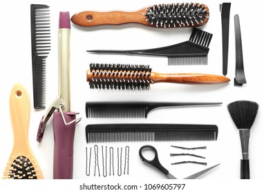 Professional hairdresser's tools on white background, top view