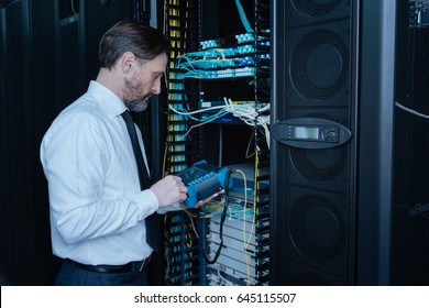 Professional handsome engineer doing a system check