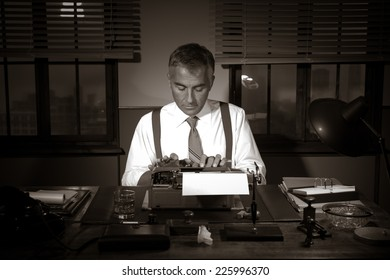 Professional handsome reporter working at office desk, 1950s style.