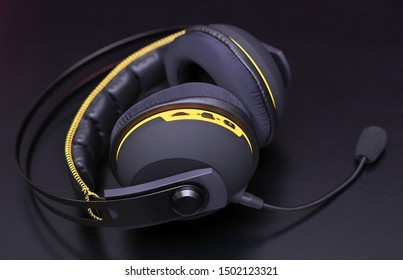 Professional headphones with a microphone for gamers on a black background