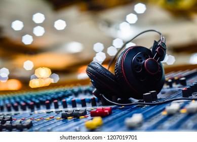 Professional Headphones on sound mixer in recording studio.