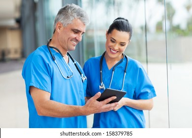 professional healthcare workers using tablet computer