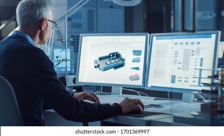 Professional Heavy Industry Engineer Works on Computer Uses CAD Software with Integrated development environment to Design Industrial Machinery Component. Over the Shoulder Shot