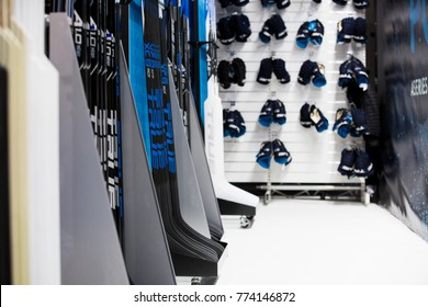 Professional hockey equipment store . Rows of hockey sticks and gloves in sport shop. Finland, Helsinki. December 3 2017.