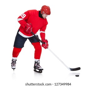 Professional hockey player skating on ice. Isolated on white