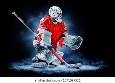 Professional ice hockey goalkeeper or goalie or goaltender isolated on black backgroung