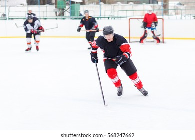 Professional Ice hockey player with stick skating on the rink. Image with copy space