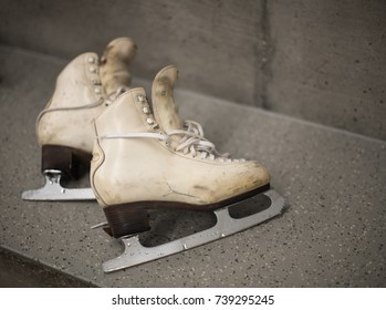 Professional ice skating shoes in dressing room after training