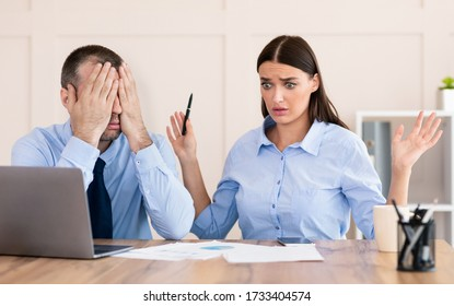 Professional Incompetence. Businessman Covering Eyes Unable To Train Silly Intern Girl Sitting In Modern Office.