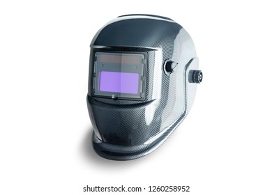 Professional industrial auto-darkening protective welding helmet made of carbon fibers, isolated on white background with shadow
