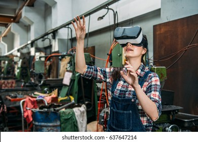 professional industrial factory woman with VR technology product standing in equipment room and hands moving on air experience 3D video at milling machine work room.