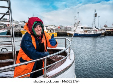 professional industrial happy fisherman on the ship show thumb up