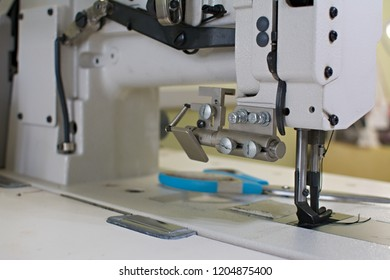 professional industrial sewing machine, sewing machine in production, sewing workshop, leather workshop, sewing and repair of clothing