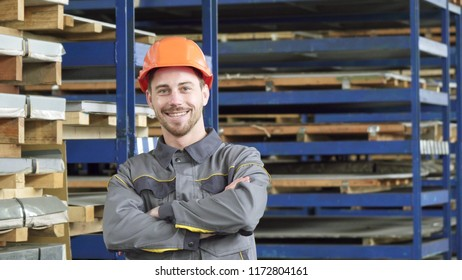 Professional industry worker smiling wearing hardhat smiling to the camera
