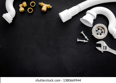 Professional instruments for plumber on black background top view space for text