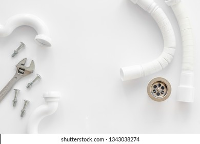 Professional instruments for plumber on white background top view space for text