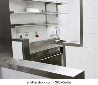 Professional kitchen in a fast food restaurant in Tel Aviv. All the equipment is made of stainless steel.