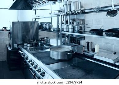 Professional kitchen interior, crock on stove, toned image