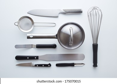 Professional kitchen utensils on white background overlook shot