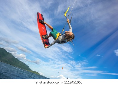 professional kiter makes the difficult trick on a beautiful background of beautiful clouds of Mauritius
